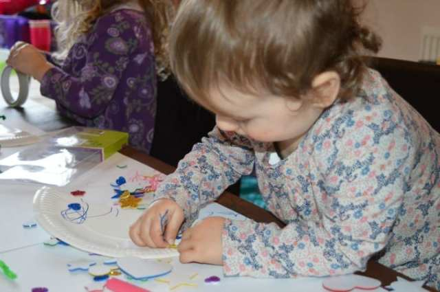 toddler doing crafts