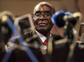 Robert Mugabe admits it is time for 'regime change' and hints he will retire