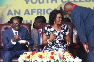 Resident-Mugabe-eating-cake-while-his-wife-Grace-chat-with-some