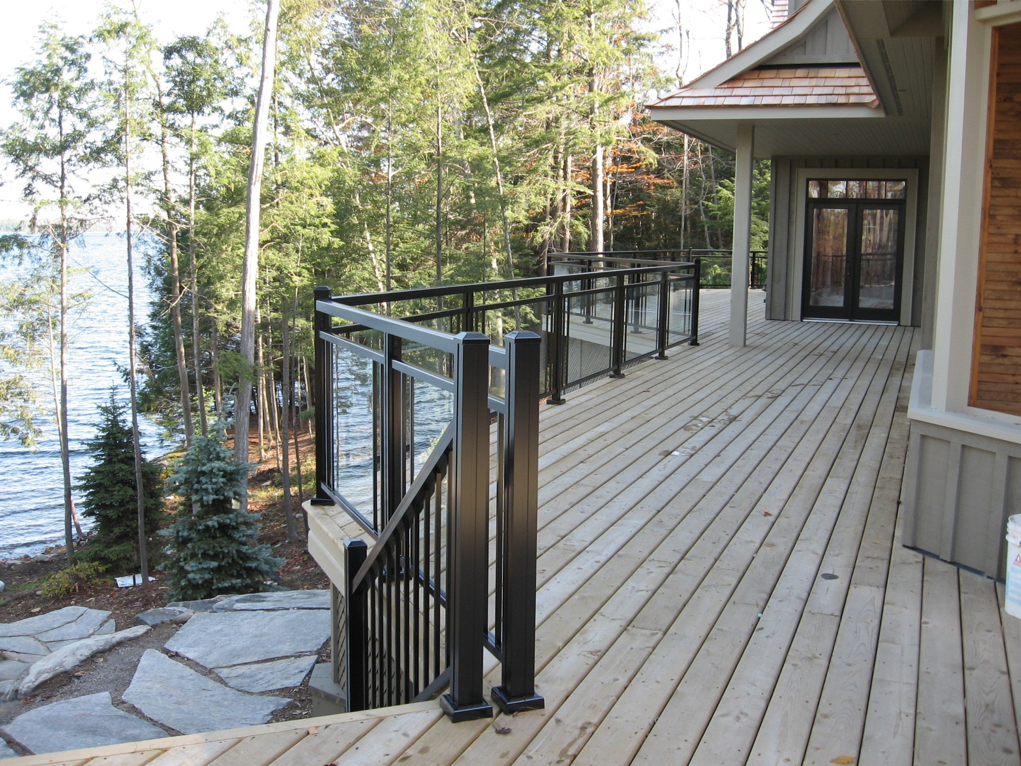 Craft-Bilt railing surpasses the industry. Thicker handrail extrusion, heavy aluminum posts, all engineered to meet the building code. Unmatched appearance, no visible fasteners and no plastic components, all extruded and cast aluminum parts. Best railing for your prestige cottage property, boat house railing and summer home balcony.