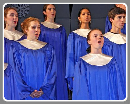 """The Staples Choir's rendition of """"Holy Night, Silent Night"""" was hauntingly beautiful. (Photo by Lynn U. Miller)"""