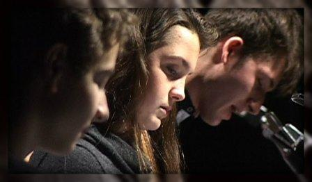 """Will Haskell, Keleigh Brockman and Bryan Gannon intently perform """"It's a Wonderful Life."""""""