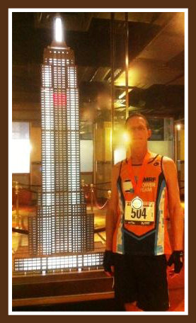 David Schachne, with a model of the Empire State Building. The actual building is somewhat taller.