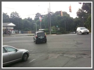 A typical scene: Two drivers -- from opposite directions -- head through clear red lights. This scene is at the Post Road,Roseville and Hillspoint intersection.