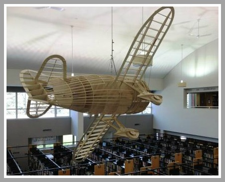 This plane is one of 2 made last summer in the library's new maker space, under the direction of Joe Schadt. It's a permanent addition to the ceiling -- unless it decides to fly off somewhere.
