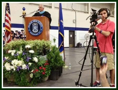 Principal John Dodig greets the crowd of 3,000. The ceremony was televised, and will soon be shown on Cablevision Channel 78.