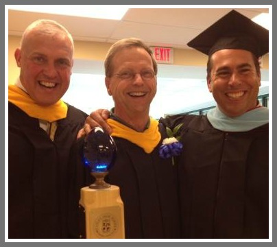 Assistant principals Rich Franzis (left) and Jim Farnen flank Bruce Betts. The popular teacher and volleyball coach -- who is retiring after 41 years as a Westport educator -- carried the honorary faculty mace.