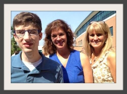 Sam Robson stands with teachers Karen Masiello and Jennifer Boland.