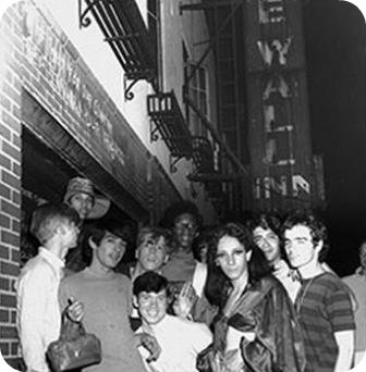 Protesters posing at the Stonewall Inn, soon after the 1969 riots.
