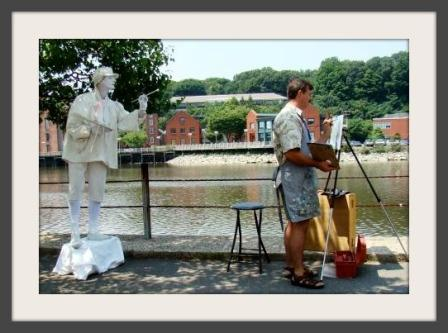 A mime and artist, both hard at work during the Westport Fine Arts Festival.