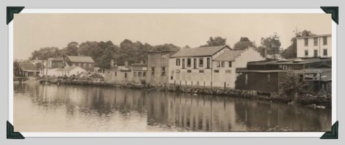 This is what the back of Main Street looked like when the Saugatuck River lapped against the stores -- before the construction of Parker Harding Plaza. It doesn't look a lot better today.