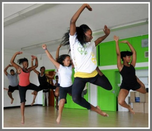 A dance ensemble class rehearses at Neighborhood Studios. (Photo by Autumn Driscoll/CT Post)