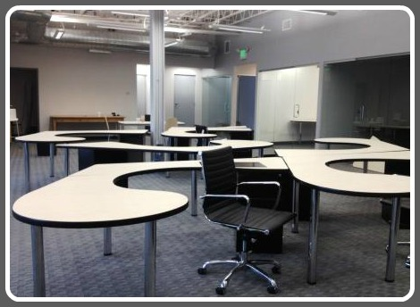 The Hub's desks invite collaboration. They're more inviting now than this photo shows; chairs have arrived since then.