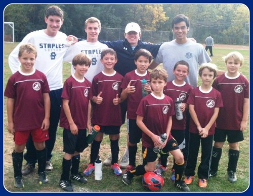 Staples boys soccer players enjoy helping the next generation of players. Last fall Sterling Price, Patrick Beusse, Charlie Leonard and Steven Sobel hung out with WSA players at Burr Farms Field.