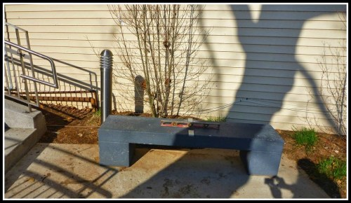 A crooked -- and hardly welcoming -- bench. That's a level on top, showing that it's not level.
