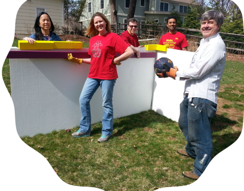 It takes human beings to design and make a Human  Foosball Table. Hard at work last weekend were (from left) Cecilia Fung, Kerstin Rao, Michael Miller, Vijay  Rao and Jeff Boak.