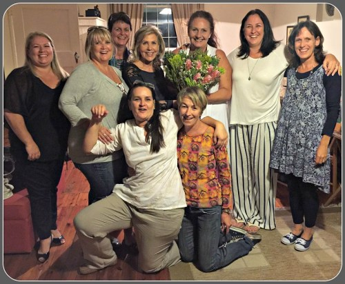 """Today, Hazel Malbin looks the same age as her former """"girls."""" She's standing, 4th from left. The proteas are South Africa's national flower."""