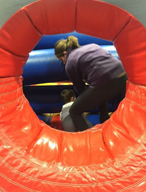 A mother wrangles her young son at the Saugatuck Elementary School bounce house.
