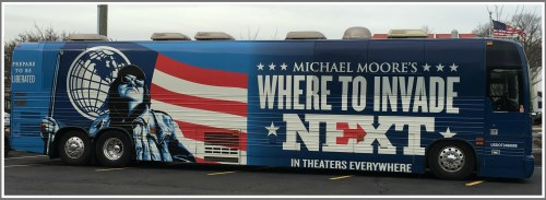 Michael Moore's bus was parked outside Bowtie Cinemas yesterday. The American flag in the background is completely coincidental. (Photo/Susan Iseman)