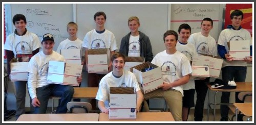 Operation Care Package club members. Cole Devine is seated in front.