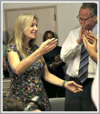 Leonora LaPeter Anton receives congratulations from colleagues.