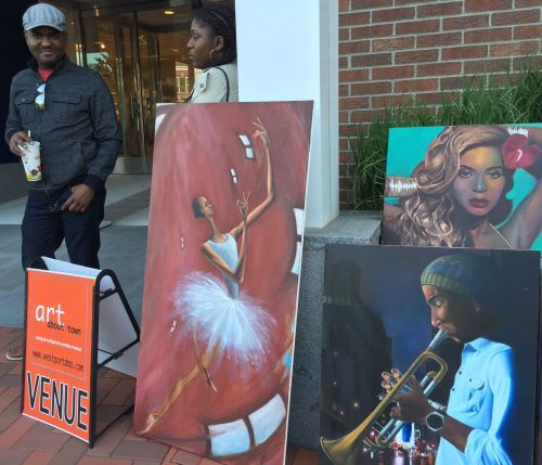 Haitian artist Jean Benoit -- now living in Stratford -- showed off his works near The Gap.