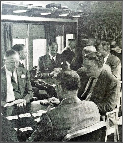 Enjoying a card game, in the elite railroad club car.
