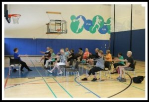 A seated yoga class, at the Westport Weston Family YMCA.