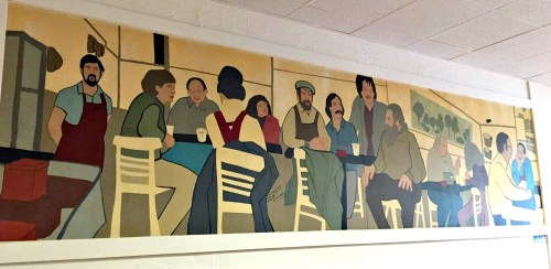 For decades, this mural has depicted a group of 1970s-era regulars. Lee Papageorge is on the left.