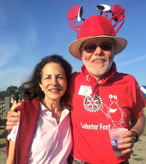 Rotary Board member Rick Benson claws State Representative Gail Lavielle.