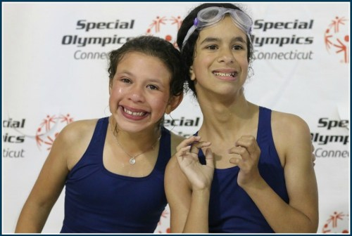 Smiles all around on the Y's Special Olympics swim team.