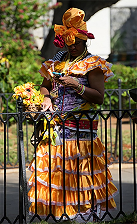 Woman in colorful dress, old Havana. (Photo copyright June Eichbaum)