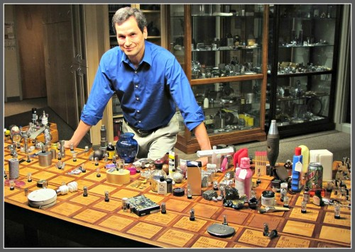 "David Pogue hosting ""NOVA."" He's standing behind a periodic table ""table."""