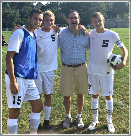 Last fall, Jon Walker was a popular presence at Staples High School soccer games. He'd lost the ability to speak, but he was embraced by the team, and responded with thumb's-up signs of encouragement. Here he is flanked by captains Josh Berman, Spencer Daniels and Daniel Reid.