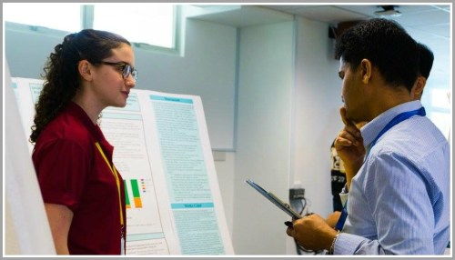 Sarah Barnett presenting her research to a judge at the International