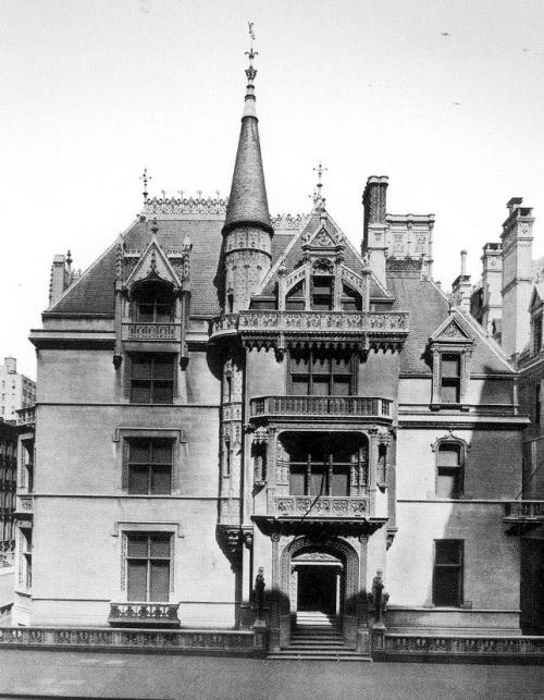 "William K Vanderbilt's 660 Fifth Avenue Mansion Spanish Revival Architecture ""Past an entrance vestibule lined in delicately carved stone drapery, the long main hall neatly bisected the house. Its walls of finely detailed Caen stone contrasted with the elaborate wood ceiling. Midway through the hall, ont he right, an ornate stone arch opened onto the grand staircase. Around the rest of the hall, the principal entertaining rooms were arranged. A French Renaissance library and a reception room with intricate inlaid paneling faced Fifth Avenue; within a few years, the latter room was redecorated using a set of carved 17th century Grinling gibbons limewood pendants. On the 52nd street side was a gold and white Regence salon with a ceiling painting by Paul Baudry and an ornate beamed-ceiling breakfast room that featured Rembrandt's portrait The Noble Slav. Across the rear of the house, a two-story stone banquet hall had lower walls paneled in carved, quartered oak. During the day, the large stained-glass windows surrounding the room's upper walls bathed the 35-by-50-foot space in soft colors. The last room on this level was the exotic Moorish billiard room tucked behind the staircase. All the rooms could be thrown open on gala nights to accommodate the large throngs the Vanderbilts entertained. Suites for Mr. and Mrs. Vanderbilt and for their three children occupied the next two floors. Mirrors, hand-painted with blossoming cherry trees, paneled Mrs. Vanderbilt's bathroom. On the third floor above the great hall, a gymnasium was later converted into an Elizabethan-style supper room.""  1883 - 1926. What a waste of work. ""In February 1926, wreckers leveled Richard Morris Hunt's beautiful early French Renaissance chateau and carted the remains to an anonymous landfill. Today, a rather mundane office building stands on the site where Alva and William K. Vanderbilt once conquered society's ""400."""