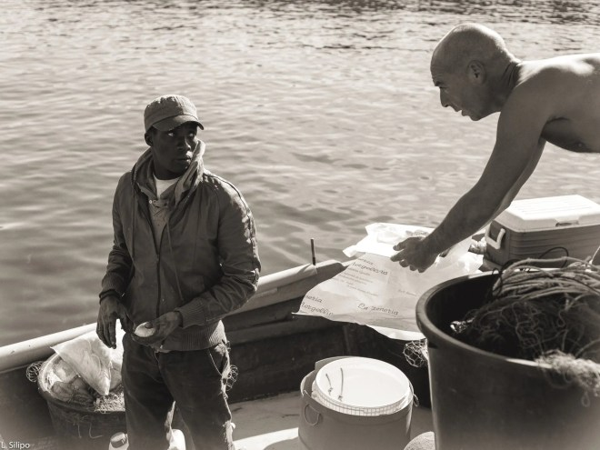 Napoli, Rotonda Diaz, air, black and white, boat, coast, coloured man, fisherman, fishermen, fishing, lifestyles, morning, naples italy, nostalgia, open, outdoor, outdoors, pastries cakes, traditional, traditional boats, work, worker