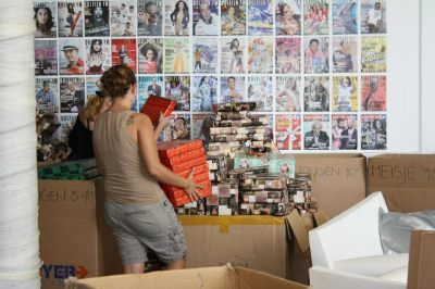 Volunteers sorting through gifts.