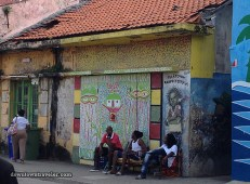 """Leslie writes: """"I spotted this painting of a defiant child on the edge of the tourist zone in Otrobanda. It shows a boy scowling under the words, """"Tula Town Respect City."""" Tula is a celebrated historical figure in Curacao – a slave who led an 18th century slave revolt. Although he was executed, Tula is remembered as a human rights activist."""" (See #692 and #683 for more on Tula)"""