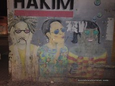 """This """"See No Evil"""" mural is an ad for Optika Hakim (a local eye glass store). Please note that all the characters are wearing sunglasses, shielding them from 'evil' :)"""