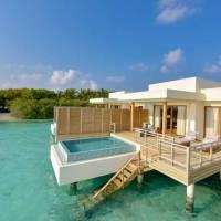 Im Dhigali Maldives erleben Gäste minimalistische Eleganz im Paradies