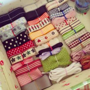 Photo of a collection of ribbons all arranged in a box