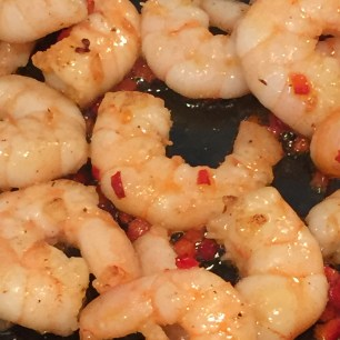 A photo of the prawns frying with garlic and chilli