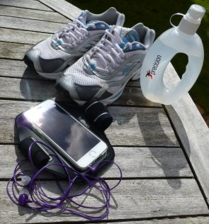 A photograph of Emma's faithful old trainers with new water bottle and mobile phone arm strap