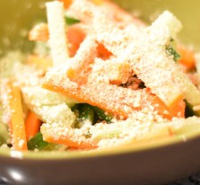 A photograph of the carrot & cucumber salad with a sprinkling of crushed cashews