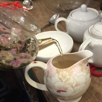 A photograph of the tea being poured into the Jug of Fairness