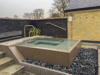 A photograph of the rooftop hot tub