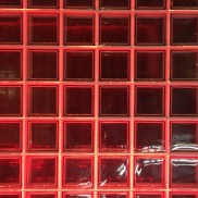 A photograph of a glass wall with red chequerboard pattern to demonstrate pattern and repetition. It was taken at the Guinness Storehouse in Dublin.
