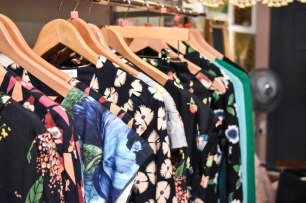 A photograph of a rack of Emily and Fin autumn winter dresses hanging on a rail