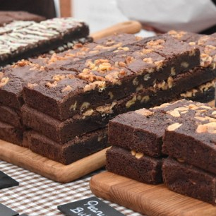 A photograph of rows of chocolate brownies for sale